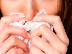 Förkylningssymtom (genrebild).